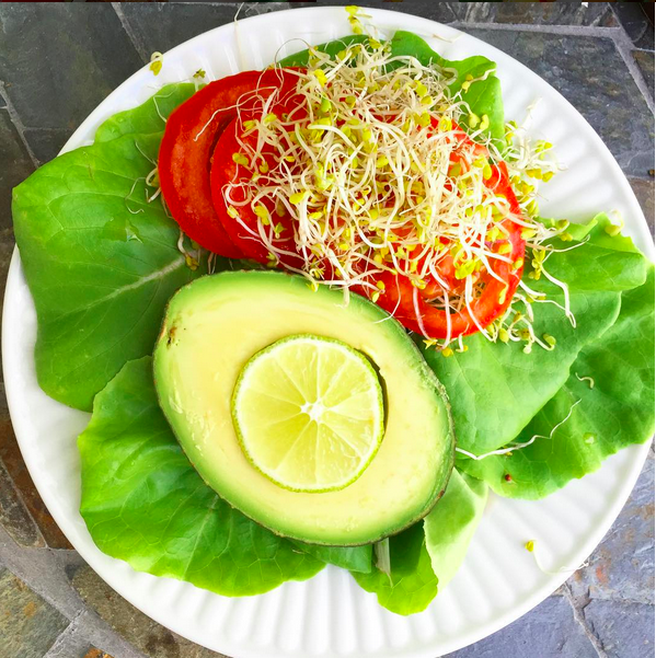 Bibb lettuce with avocado, tomato, sprouts, lime, and a tspn of whole grain dijon mustard.